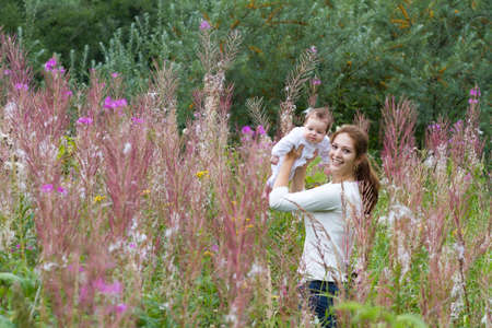 uncultivated: Mother and baby girl in uncultivated lands