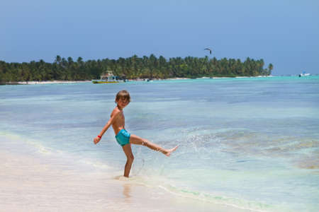 turqoise: Young boy playing in the turqoise water of a Caribbean island