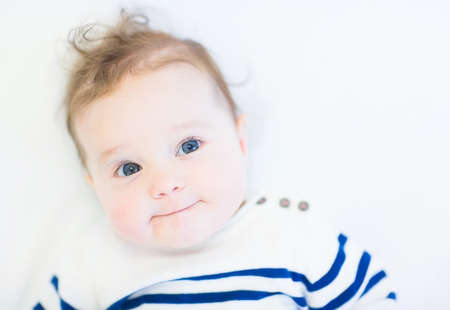 Funny baby in a striped navy shirt