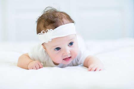 Sweet baby girl trying to crawl  photo