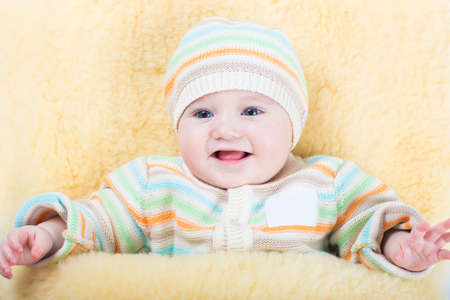 muff: Little baby in a stroller sitting in a warm sheep skin foot muff