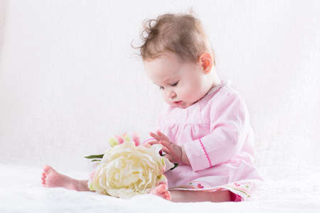 sweetest: Sweetest little baby girl playing with a huge white flower