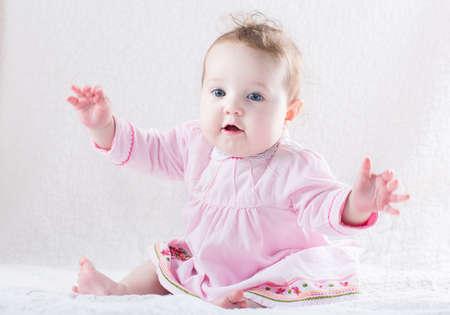 baby sit: Funny baby girl giving a hug