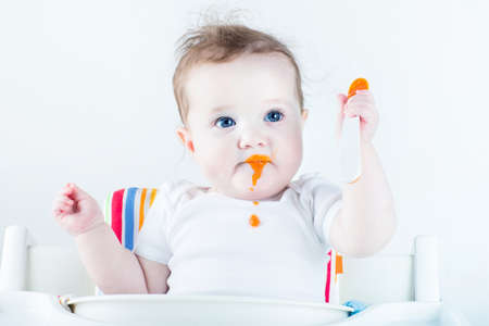 baby eating: Adorable baby girl eating vegetables for the first time
