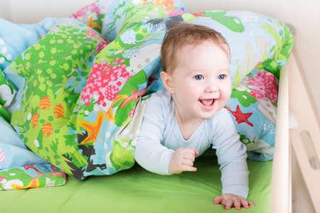 peekaboo: Happy laughing baby playing peek-a-boo