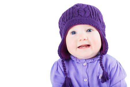 Beautiful Baby Girl With Blue Eyes Wearing A Purple Sweater And ...