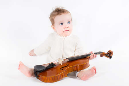 Little girl playing with a violin