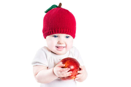 big apple: Funny little baby with a big red apple