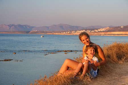 Beautiful family enjoying the evening on a beach  photo