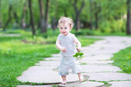 first day: Beautiful baby girl walking in the park