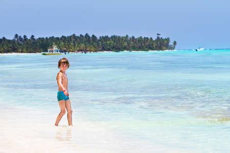 boy swim: Cute little boy playing on the beach