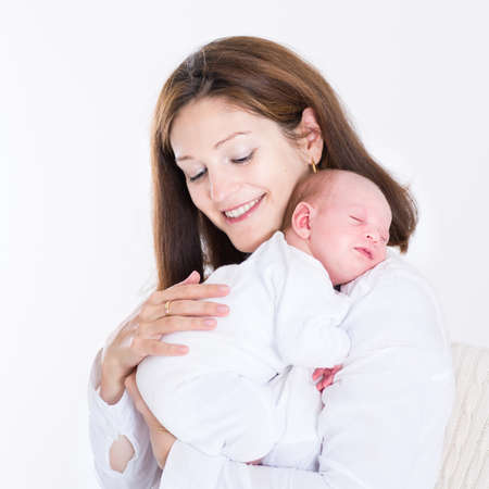 new born baby girl: Young mother holding her newborn sleeping baby