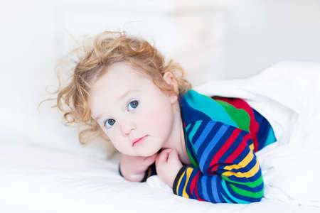 Portrait of a cute toddler girl just woke up early in the morning  photo