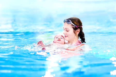 Little baby boy first time in a swimming pool