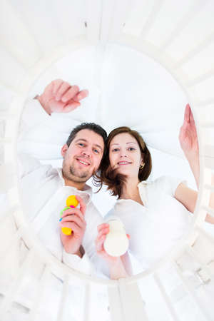 Young parents looking at their baby in a round crib - view from baby perspective   photo