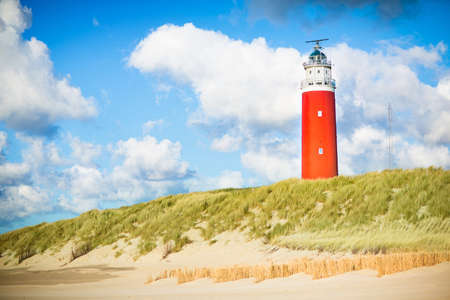 north holland: Beautiful red lighthouse of Texel island in the North Sea in Holland, Netherlands