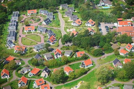 aerial views: Aerial view of a residential community, village of Haamstede, Netherlands, photo taken from above during a helicopter from air