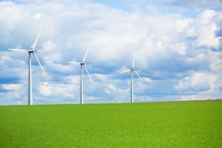 Modern energy wind mill for renewable power generation, ecological awareness concept 写真素材