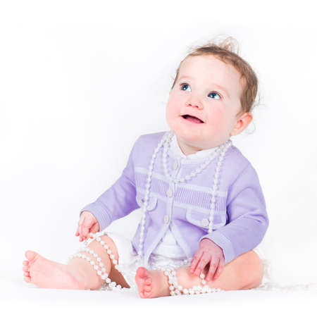 Elegant little girl with a pearl necklace photo