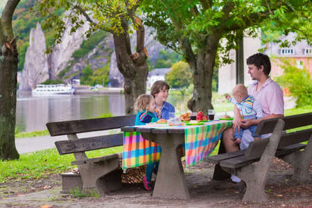 Father and kids at picnic photo