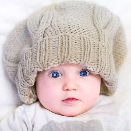 Baby in a knitted hat photo