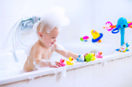 bath room: Baby in bath