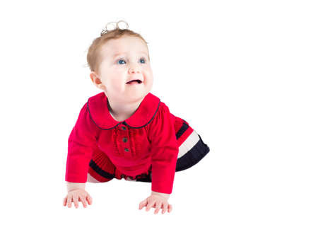 crawling baby: Funny crawling baby girl in a red dress