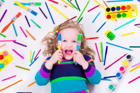 Child with draw and paint supplies. Kids happy to go back to school. Preschool kid learning and studying. Creative children at kindergarten. Office and art supply objects collection.