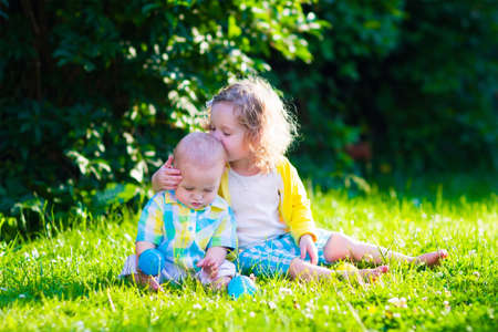 Children Playing In The Garden. Toddler Kid And Little Baby Play ...
