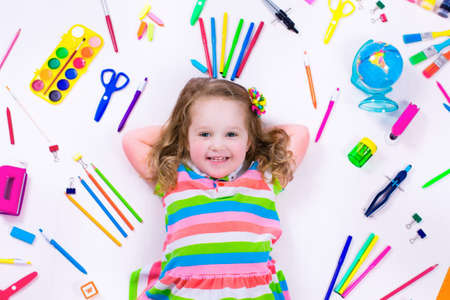 Child with draw and paint supplies. Kids happy to go back to school. Preschool kid learning and studying. Creative children at kindergarten. Office supply objects collection. Stok Fotoğraf