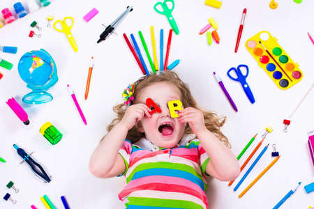 Child with draw and paint supplies. Kids happy to go back to school. Preschool kid learning and studying. Creative children at kindergarten. Office supply objects collection. Imagens