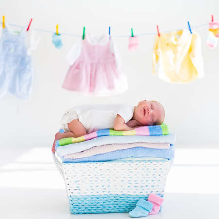Newborn Baby On A Pile Of Clean Dry Towels New Born Child After Bath In