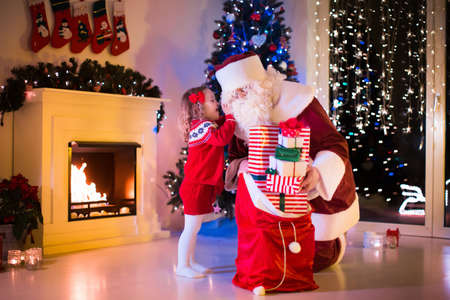 Santa Bringing Sack In The Living Room With Christmas And New ...