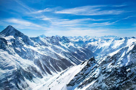 france station: Aerial view of the Alps mountains in Switzerland. View from helicopter in Swiss Alps. Stock Photo