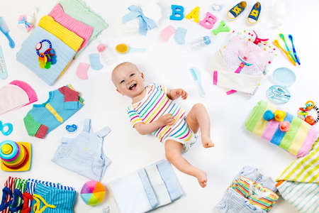 clippers comb: Baby on white background with clothing, toiletries, toys and health care accessories. Wish list or shopping overview for pregnancy and baby shower. View from above. Child feeding, changing and bathing Stock Photo