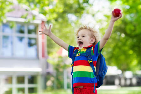 Child going back to school. Start of new school year after summer vacation. Little boy with backpack and books on first school day. Beginning of class. Education for kindergarten and preschool kids. Stock Photo