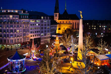 Christmas fair in Luxemburg. Aerial view of traditional Xmas market in old European city center. City decorated for winter holidays. Amusement and shopping for Christmas presents in Europe.