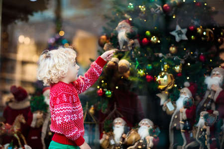 kids shopping for christmas presents children buy xmas decoration and tree little boy at