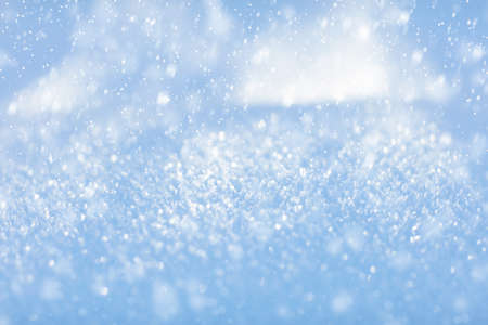Winter snow background. Close up view of fresh new snow in winter forest on sunny cold day. Ice crystals glitter. Christmas texture. Sparkling snowflakes in snowdrift. Nature.