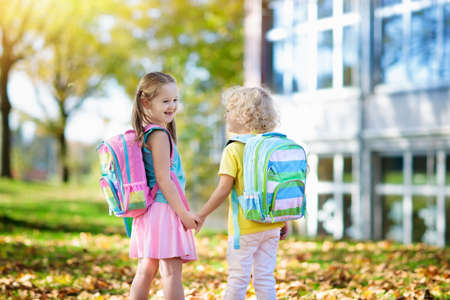 Children go back to school. Start of new school year after summer vacation. Boy and girl with backpack and books on first school day. Beginning of class. Education for kindergarten and preschool kids. Stock Photo