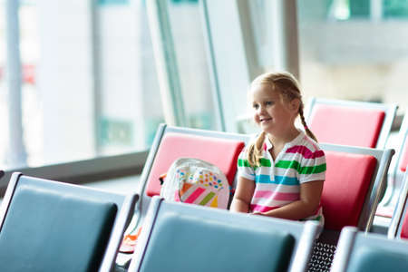 Kids at airport. Children look at airplane. Traveling and flying with child. Family at departure gate. Vacation and travel with young kid. Little girl before flight in terminal. Kids fly a plane.
