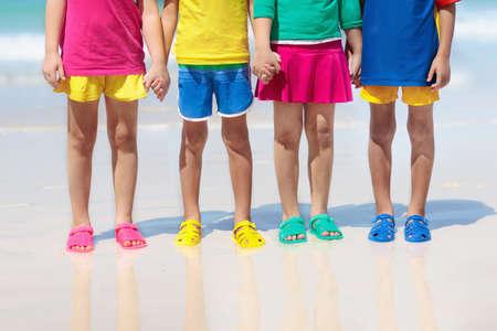 417b61c835e Kids beach shoes. Colorful footwear for boy or girl. Group of children  wearing aqua