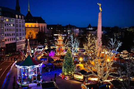 Christmas fair in Luxemburg. Aerial view of the old European city center. City decorated for winter holidays. Amusement and shopping for Christmas presents in Europe.