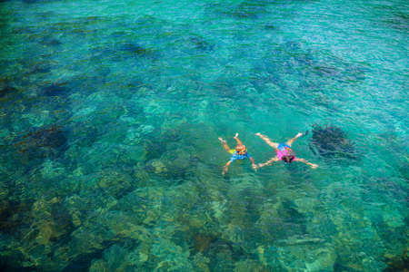 Kids snorkel. Beach fun. Children snorkeling in tropical sea on family summer vacation on exotic island. Child with mask and fins. Travel with young kid. Boy and girl learning to dive. Diving holiday. Stock Photo