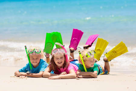 Kids snorkel. Beach fun. Children snorkeling in tropical sea on family summer vacation on exotic island. Child with mask and fins. Travel with young kid. Boy and girl learning to dive. Diving holiday. 스톡 콘텐츠