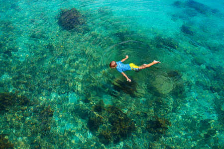 Kids snorkel. Beach fun. Children snorkeling in tropical sea on family summer vacation on exotic island. Child with mask and fins. Travel with young kid. Little boy learning to dive. Diving holiday.