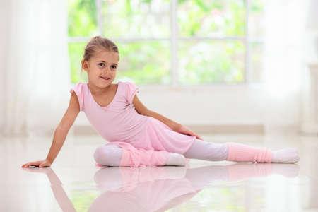 Baby ballet studio. Little ballerina in dance class. Cute girl in pink tutu and leotard learning to dance. Classic choreography for kids. Child dancer exercising. Kids practice full split.