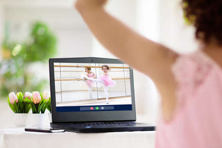 Ballet lesson online. Remote learning for kids. Teacher showing dance exercises for child via laptop computer. Video chat with student. Gymnastics practice conference call. Quarantine education.