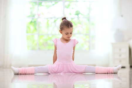 Ballet home training. Remote learning. Little ballerina in dance class. Cute girl in tutu and leotard learning to dance. Classic choreography for kids. Child dancer exercising. Online ballet course.