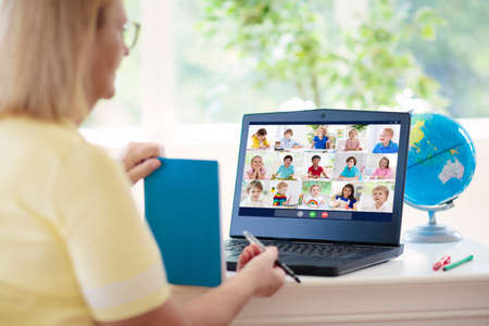 Online remote learning. Teacher with computer having video conference chat with student and class group. Teaching and learning from home. Homeschooling during quarantine and coronavirus outbreak. Standard-Bild